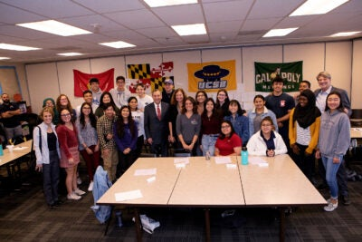 Group photo with Larry Bacow and Elisa New at at Health Science High and Middle College in San Diego.