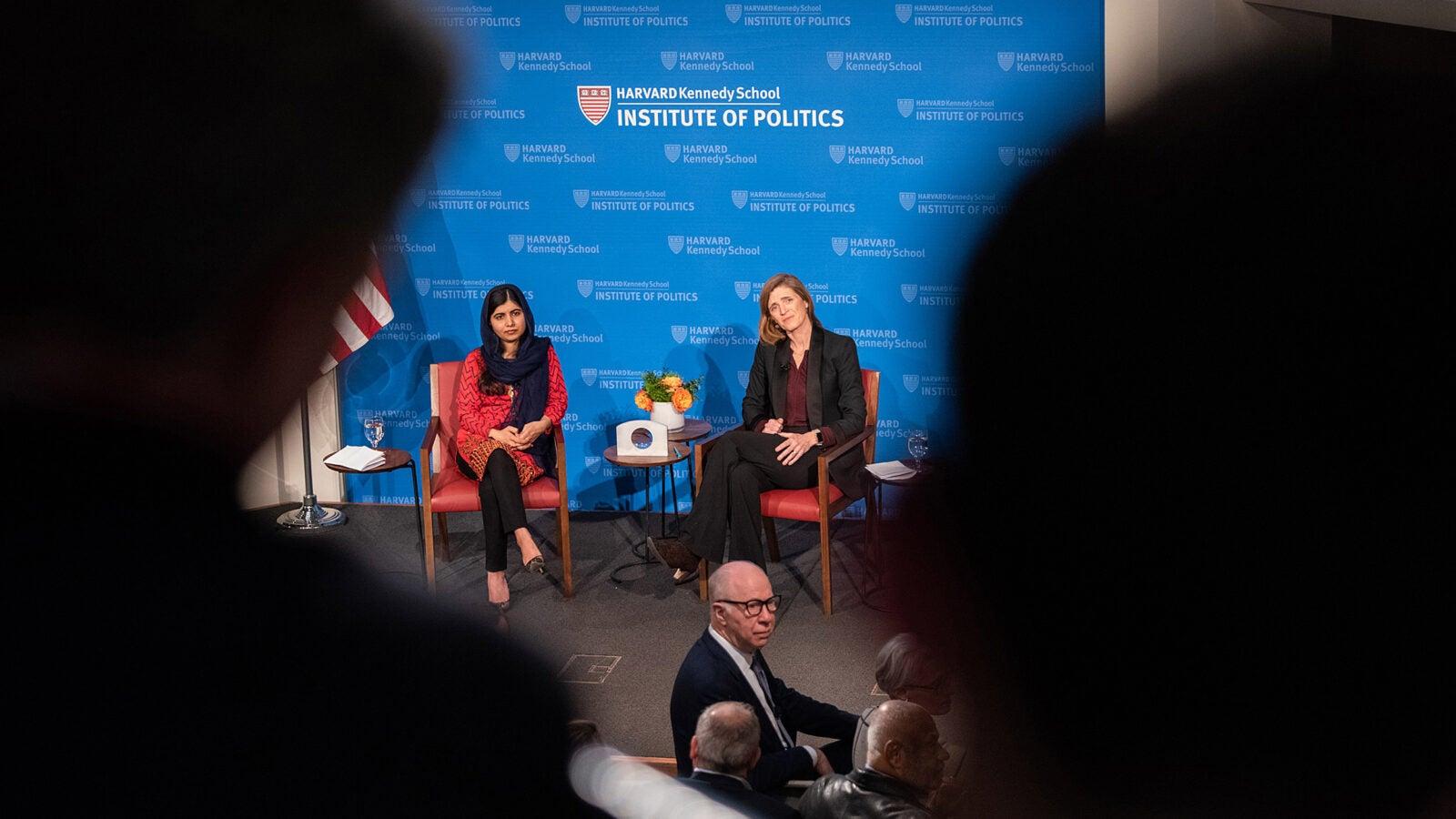 Malala Yousafzai and Samantha Power sitting on stage