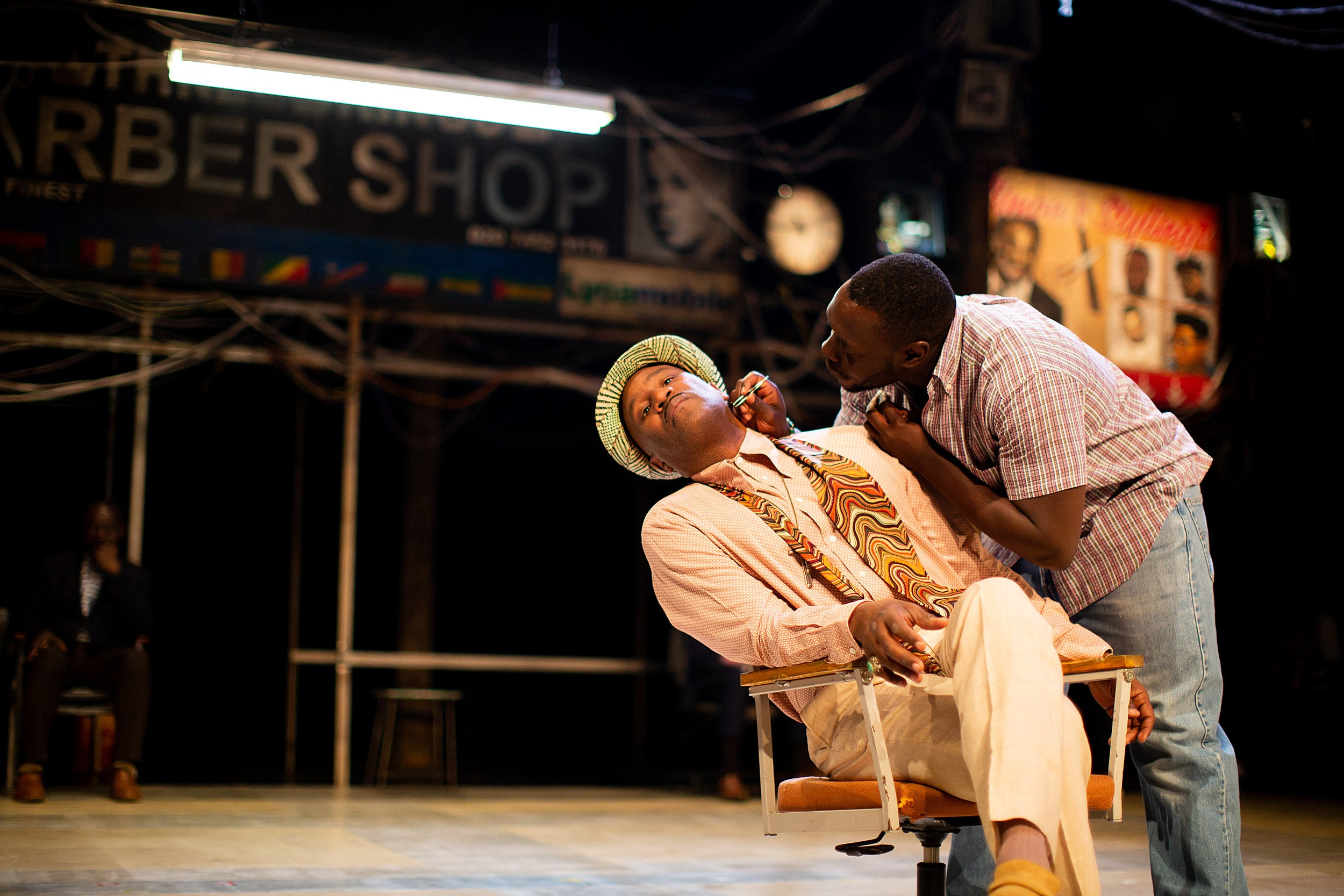 "Patrice Naiambana and Ekow Quartey in ""Barber Shop Chronicles."""