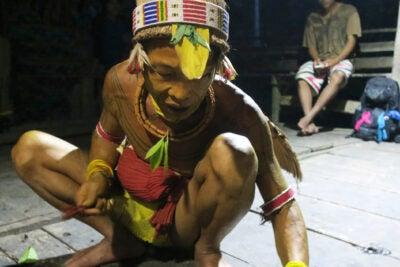 A shaman squatting