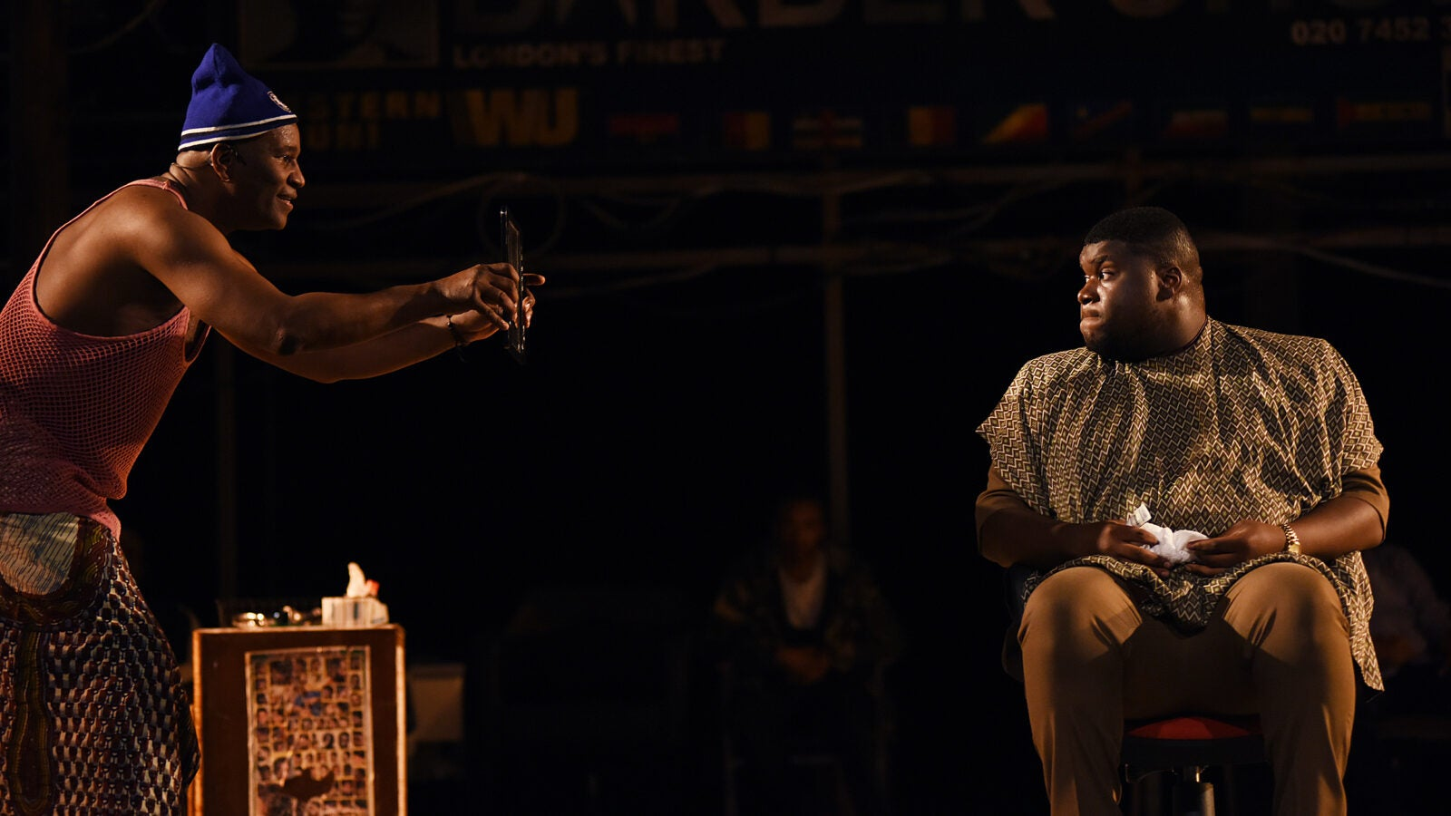 Patrice Naiambana and Tuwaine Barrett in Barber Shop Chronicles.