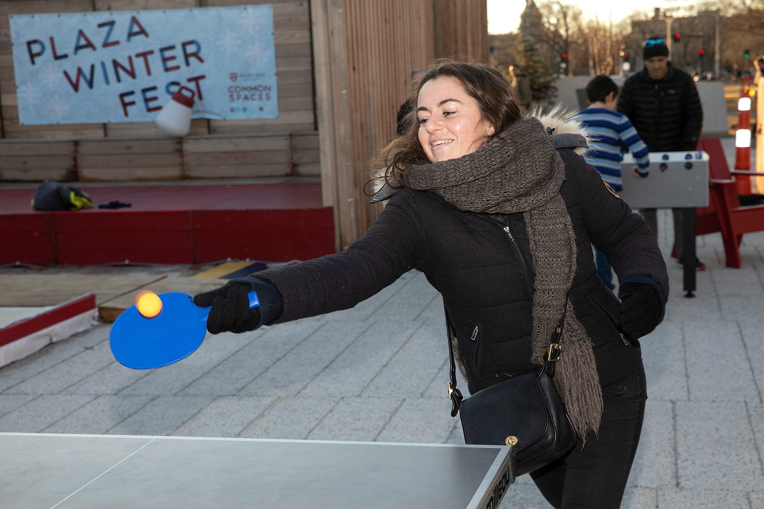 a woman playing ping pong