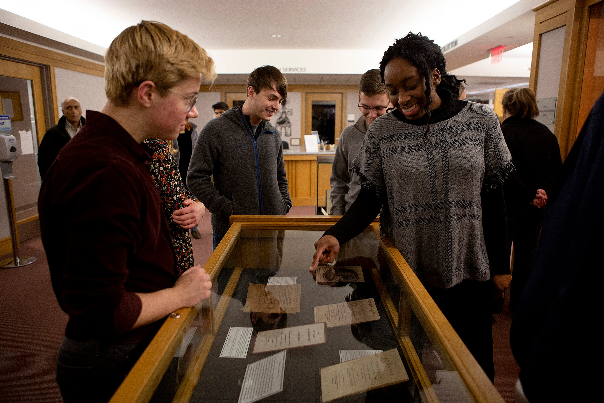 Alexandrea Harriott and classmates with their exhibit Andover-Harvard Theological Library .
