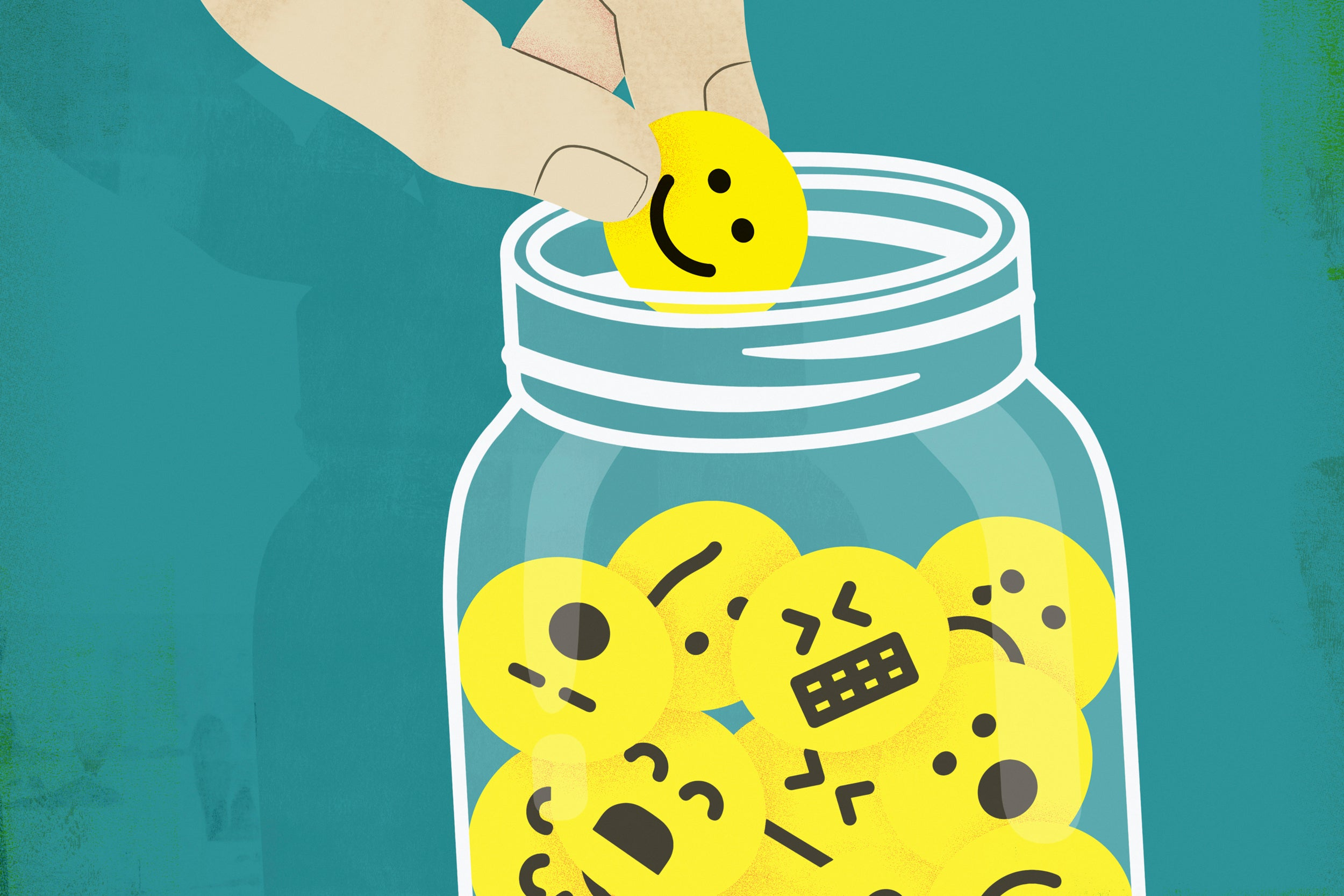 Hand choosing smiley face from jar of emoticons.