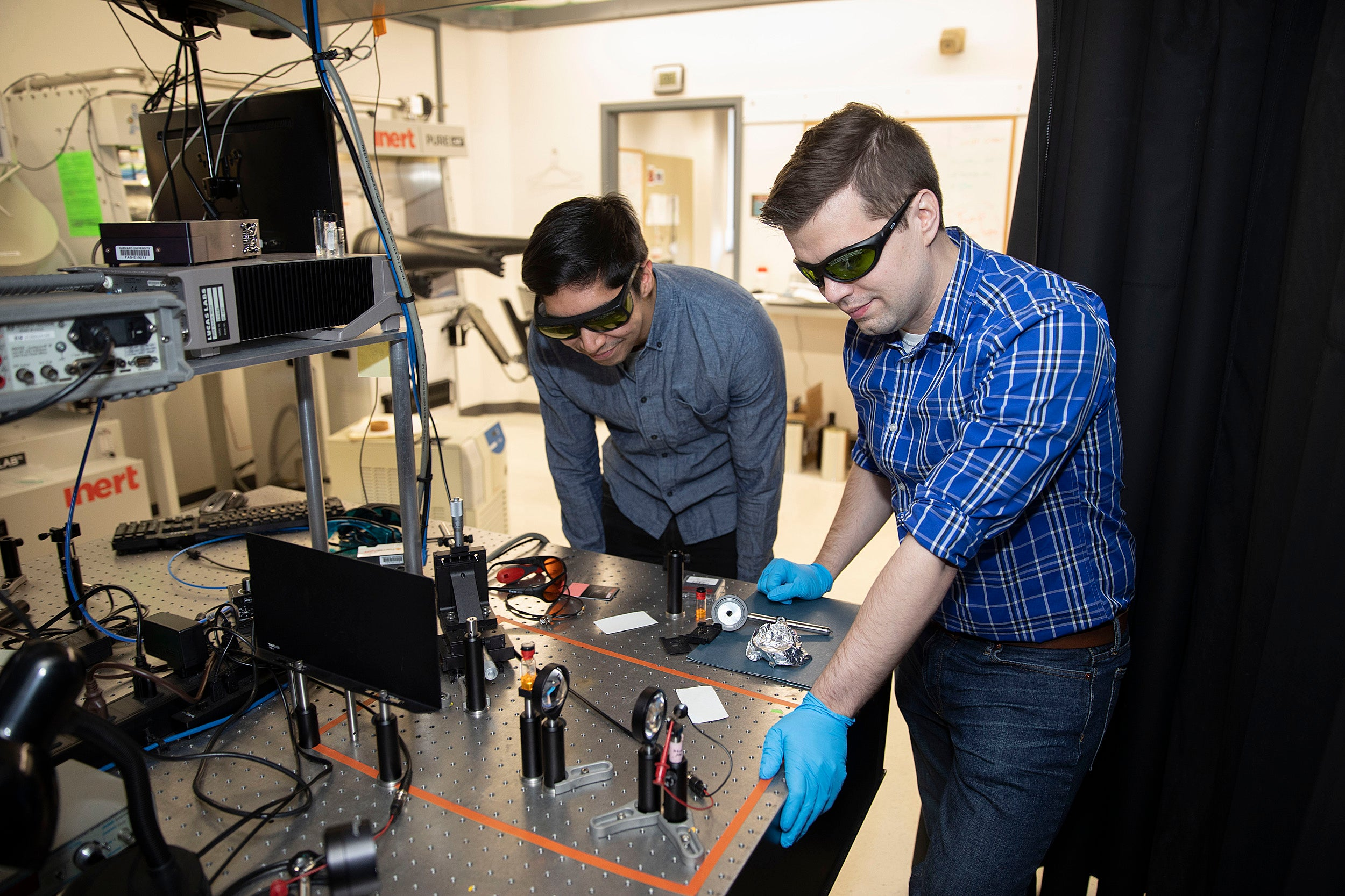 Dan Congreve and Andrew Pun work in the lab.