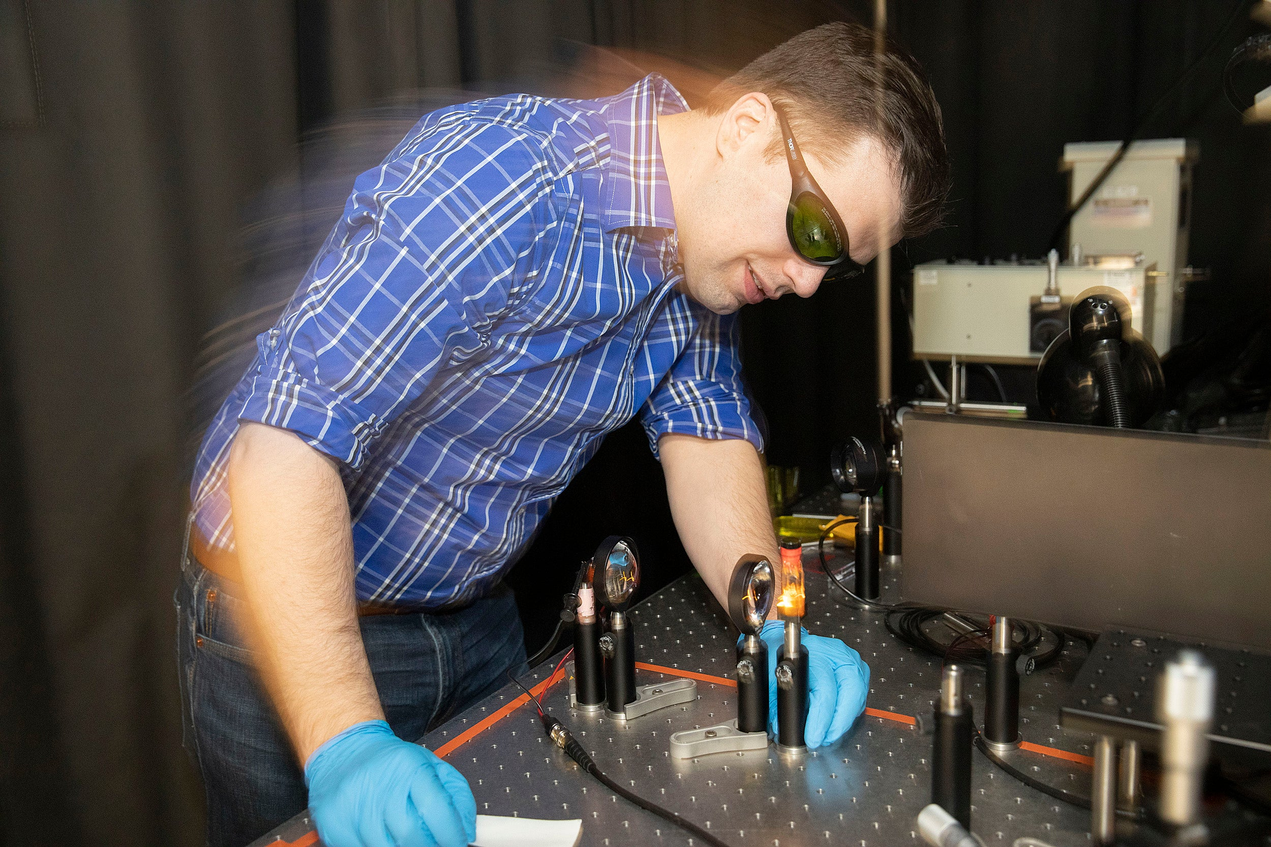 Dan Congreve works in his lab at the Rowland Institute.