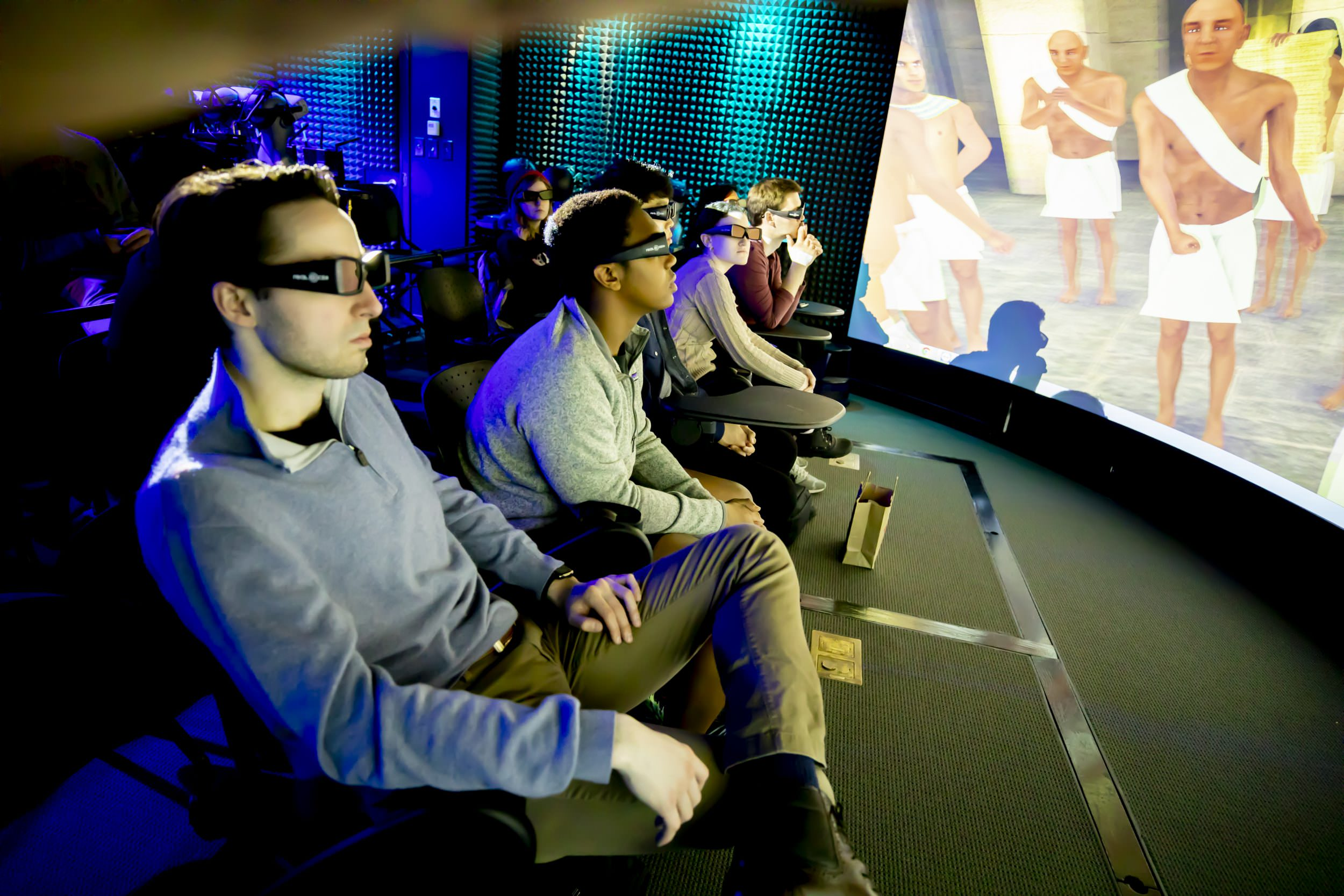 Students with 3D glasses watching a video