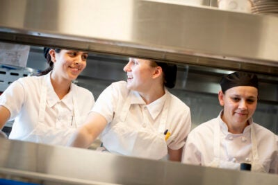 Chefs, Vanessa Portiza Acosta, from left, Corrine Gaucherin and Luz Restrepo Rincon work on the line in the kitchen at The Heights