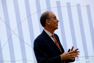 Rifat Atun speaks at a conference.