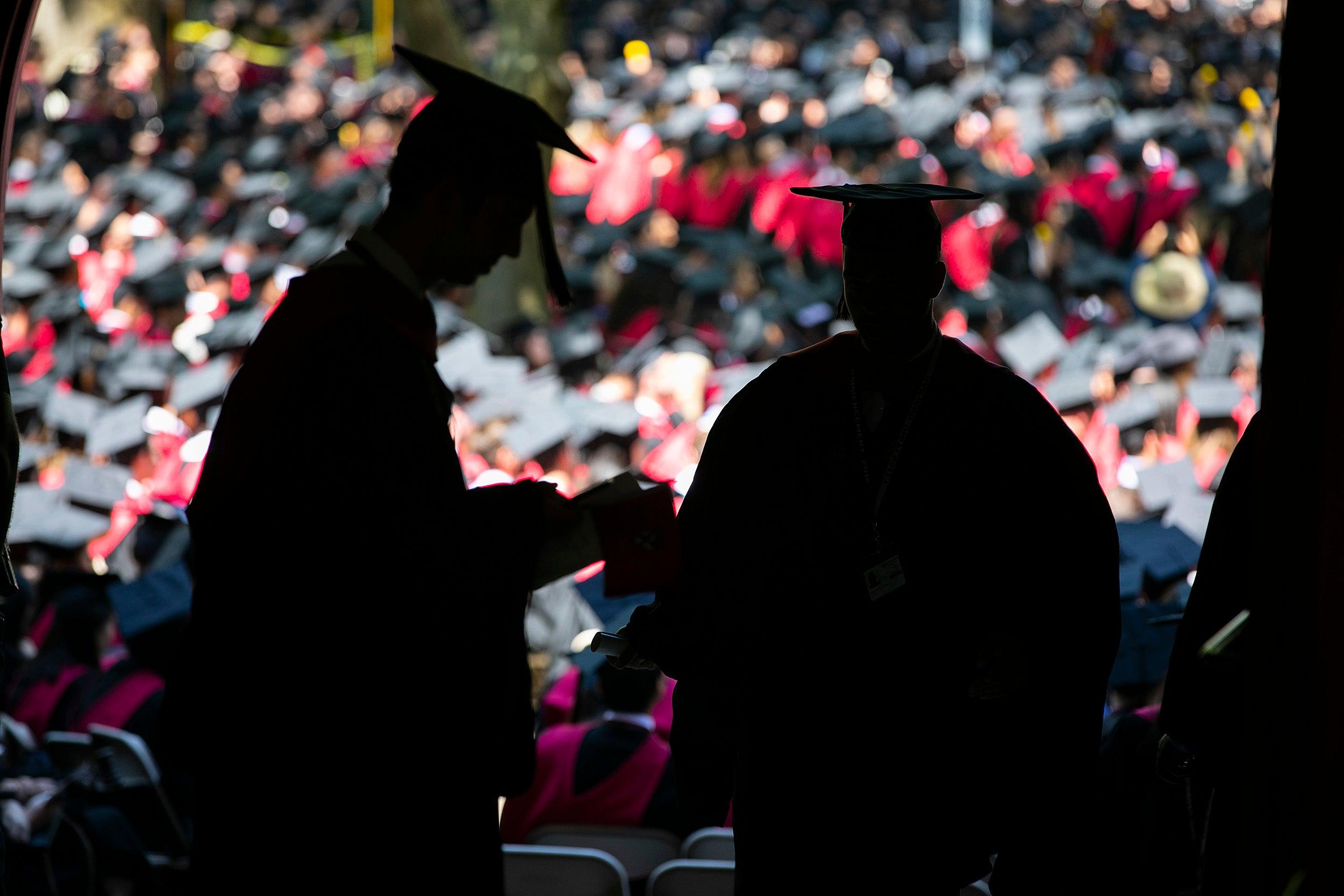Graduates in silhouette.