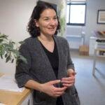 Emily Balskus standing in her office