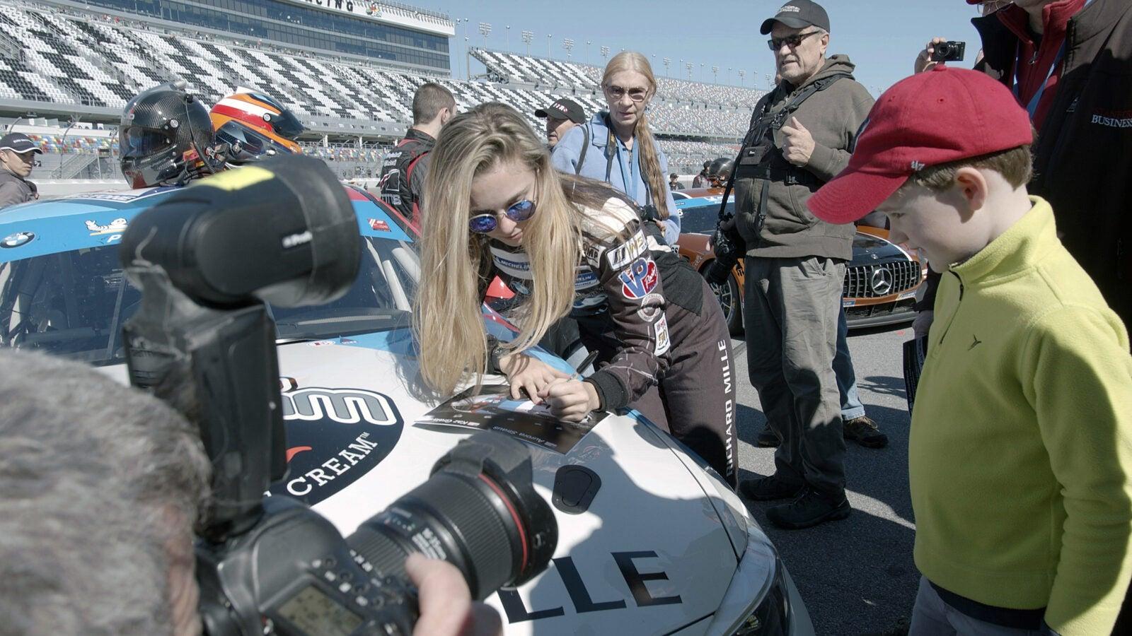 Aurora Straus signs autographs in Daytona Beach, Fla.
