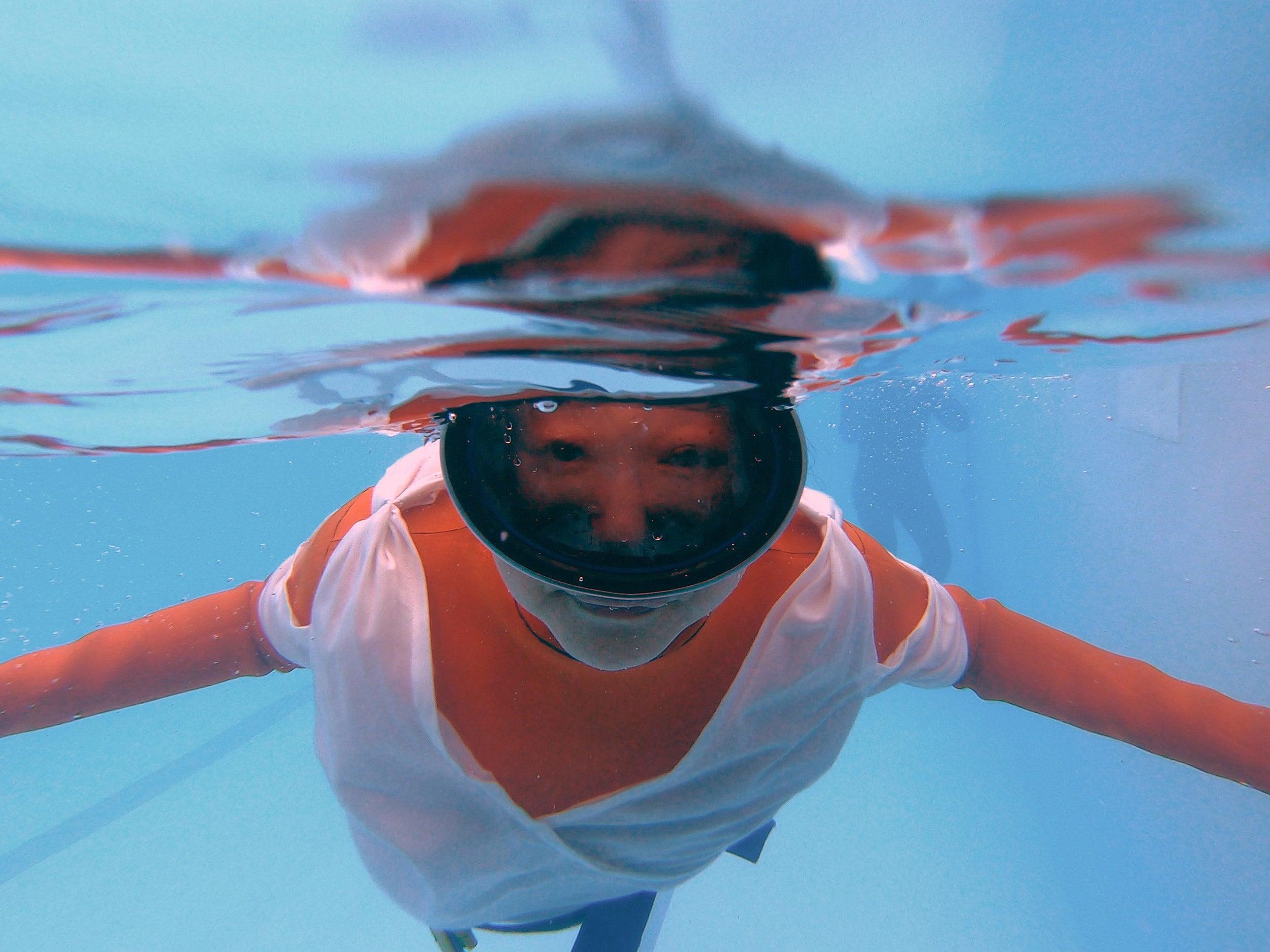 Jo Yang in rehearsal, diving underwater.