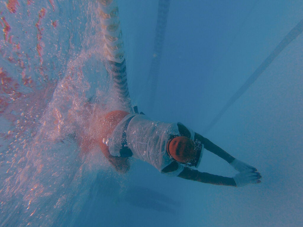 Jo Yang dives underwater.