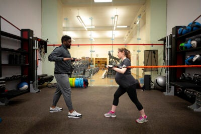 Talia Gillis works out at Hemenway gym with personal trainer Joel Waithe.