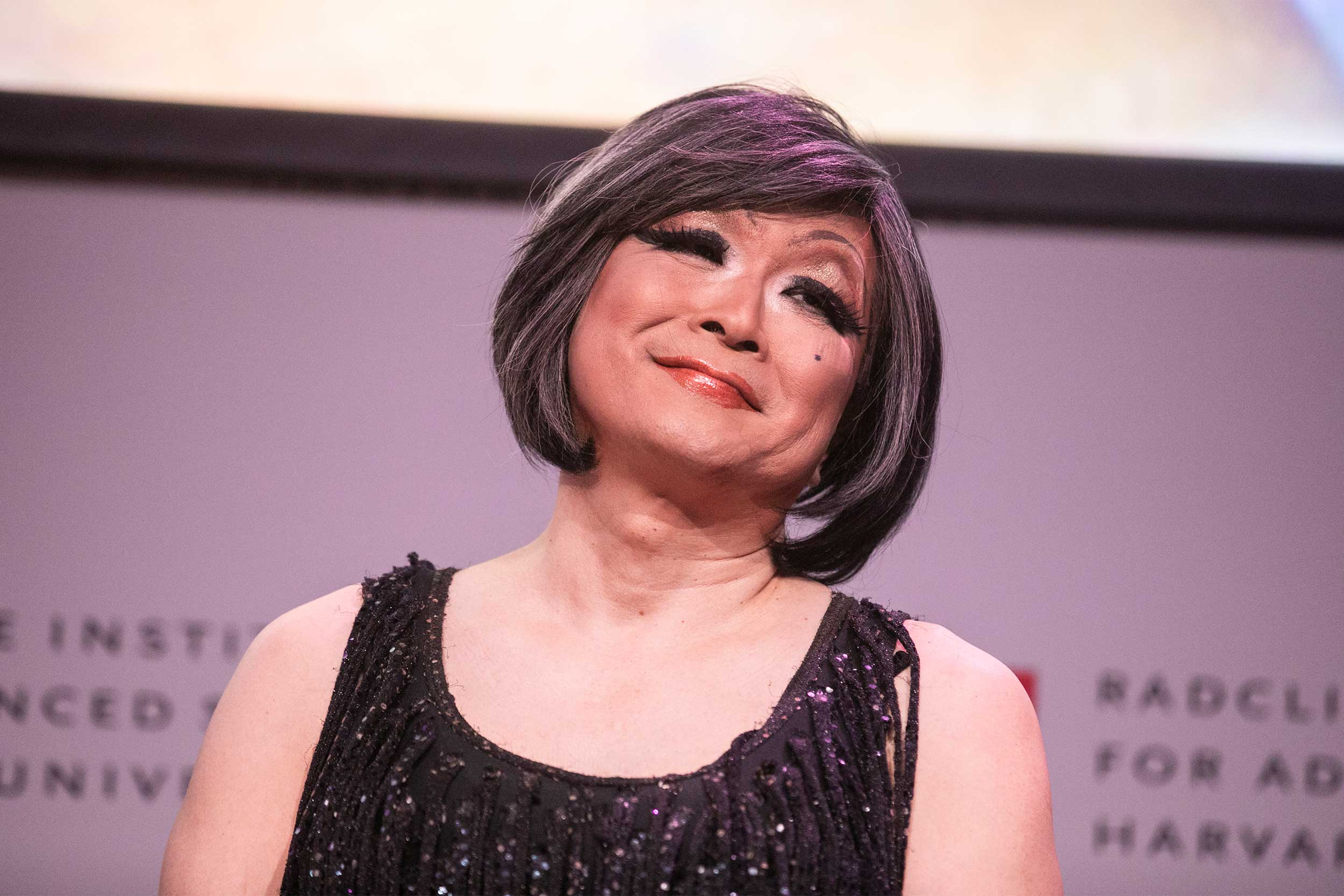 Shigehisa Kuriyama, Faculty Director of the Humanities Program, Radcliffe Institute, takes a bow after being given a gender makeover on stage.