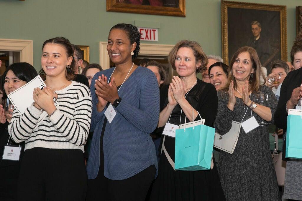Four women applauding