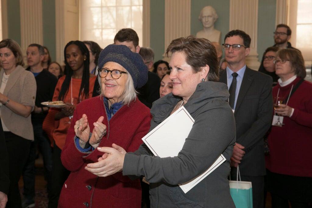 Two women applauding