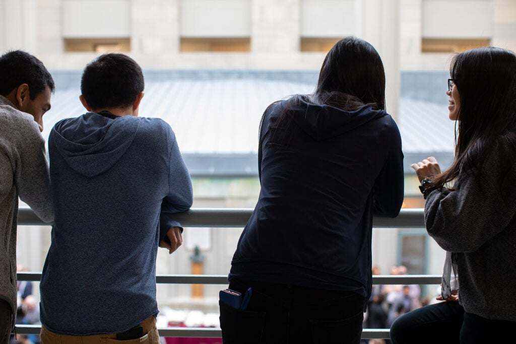 Students watch the Match Day festivities from the balcony at the Medical School.