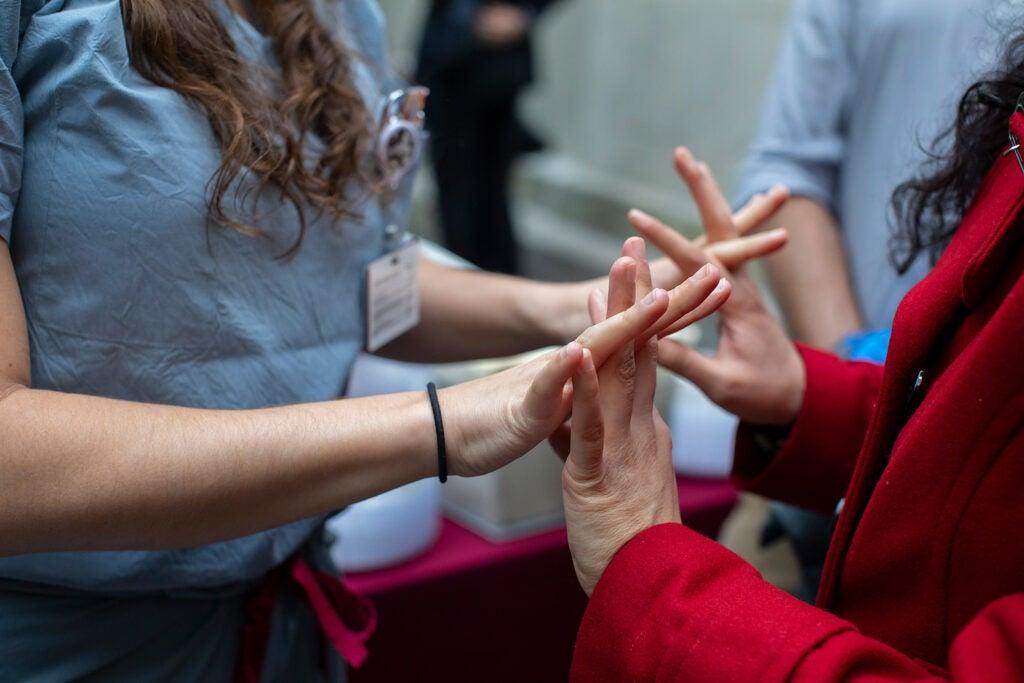 Classmates link fingers in nervous anticipation.