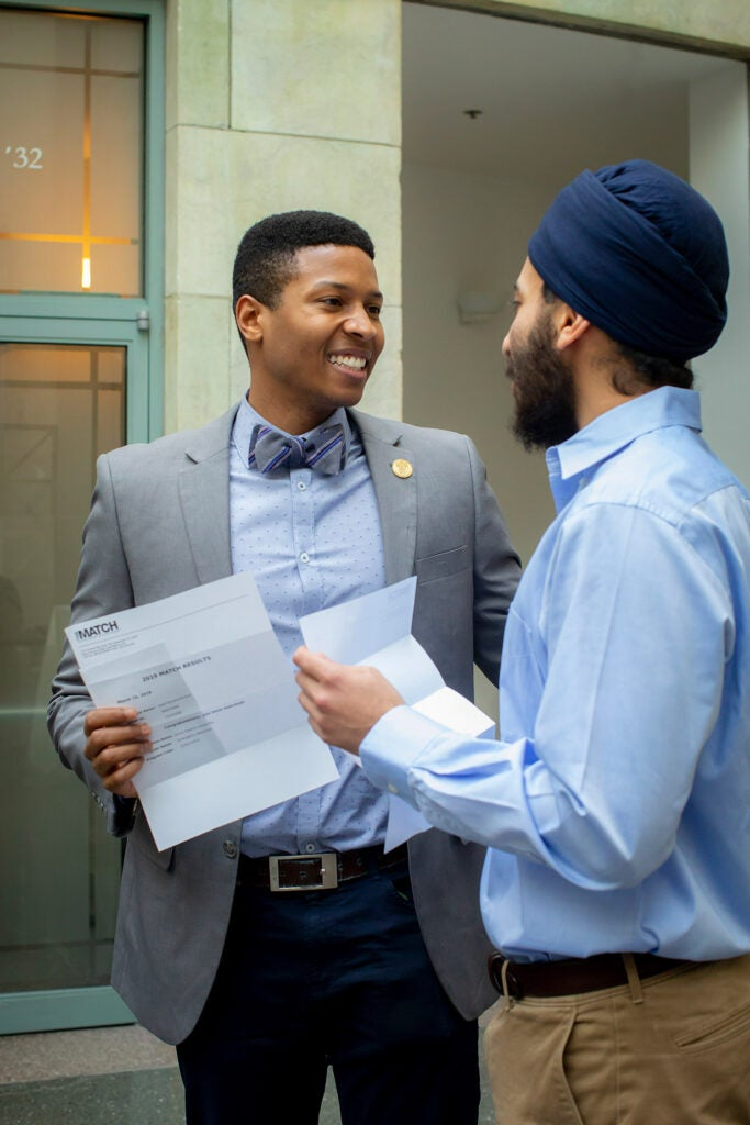Kyle Burton and Manjinder Kandola learn where they will spend the next three to seven years of training.