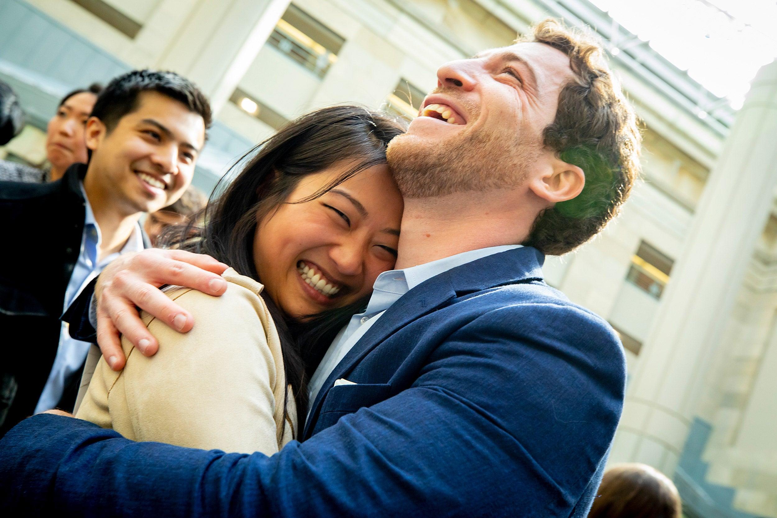 Diana Miao hugs a friend to celebrate residency.