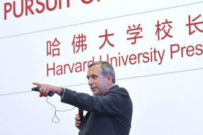 Harvard President Larry Bacow speaking at Peking University.