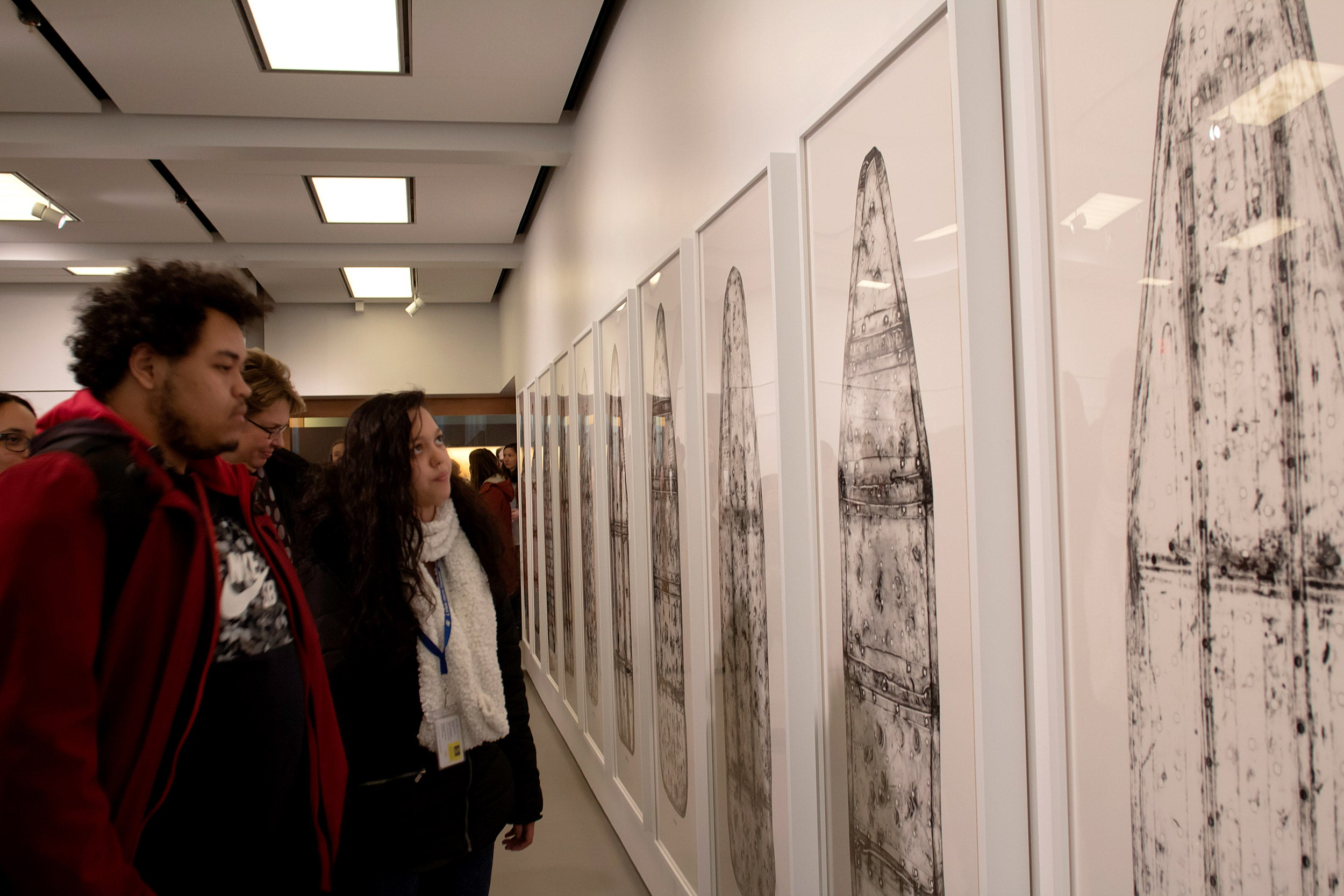 Noel Pichardo and Jasmin De La Cruz view the exhibit.