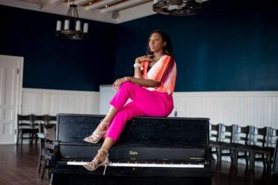 La'Toya sitting on a piano