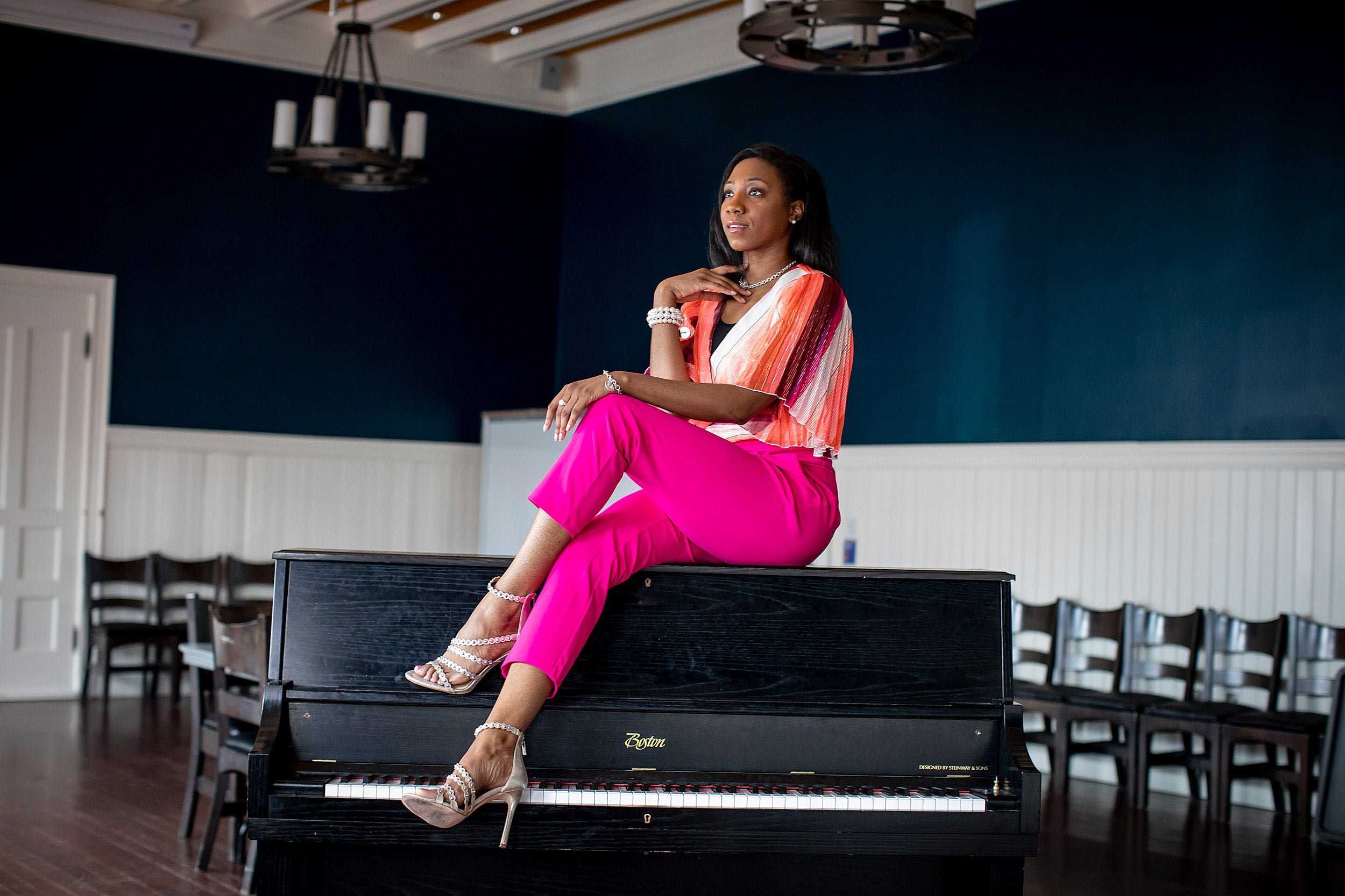 La'Toya sitting on a piano