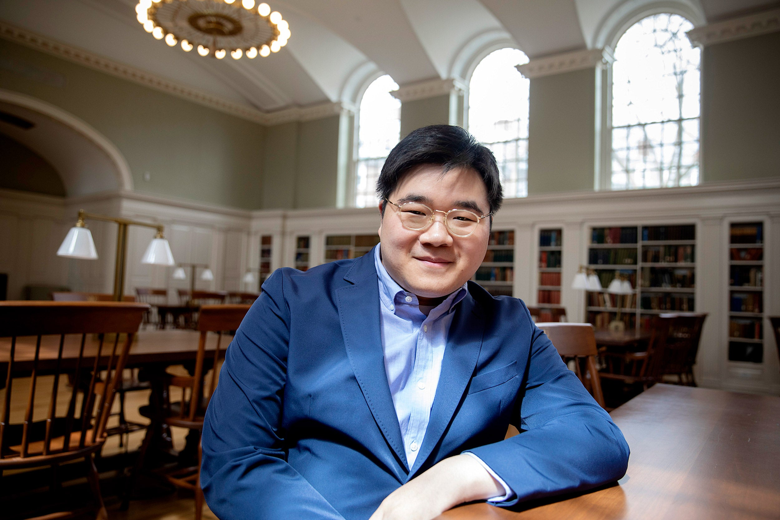 Wonik Son at the library discussing his four years at Harvard.