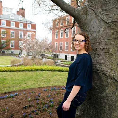 Adele Woodmansee in front of a tree