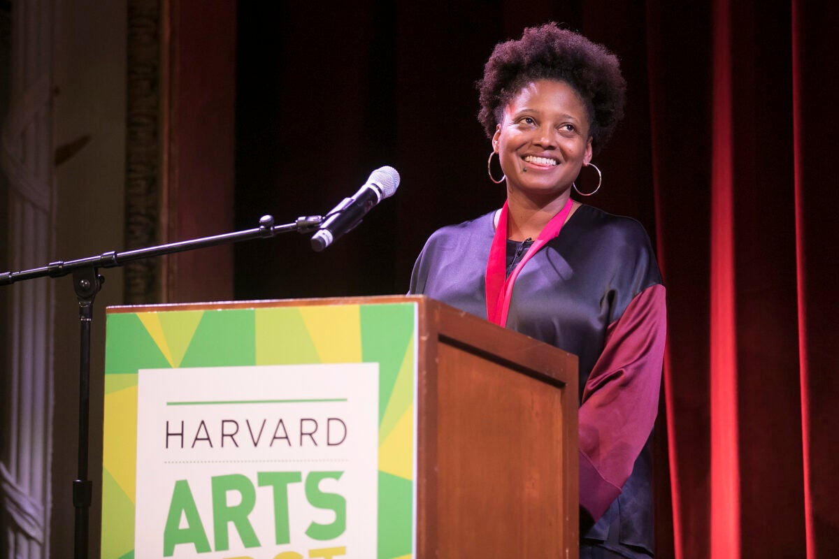 Tracy K. Smith smiles at the podium