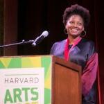 Tracy K. Smith smiles at the podium