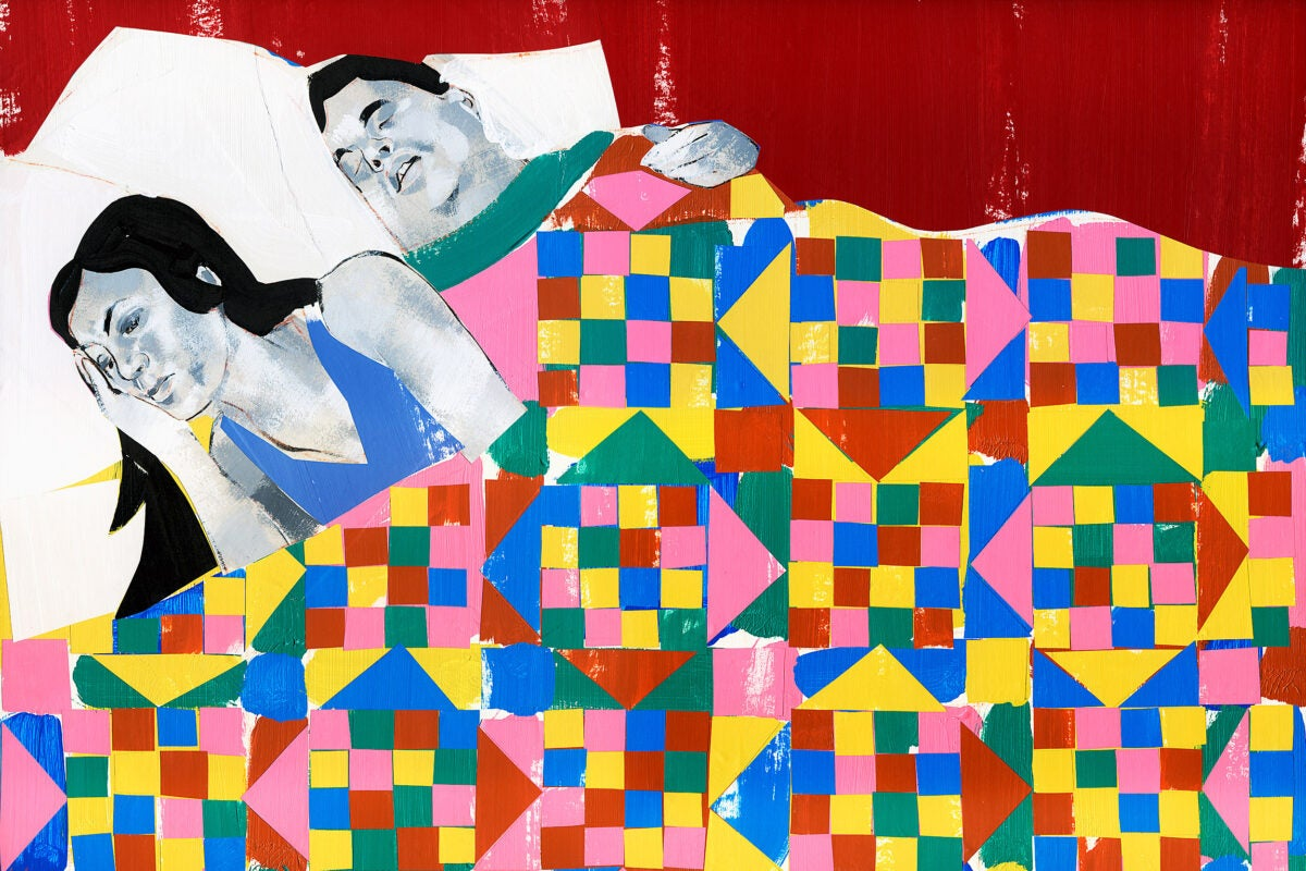 Awake woman laying in bed.