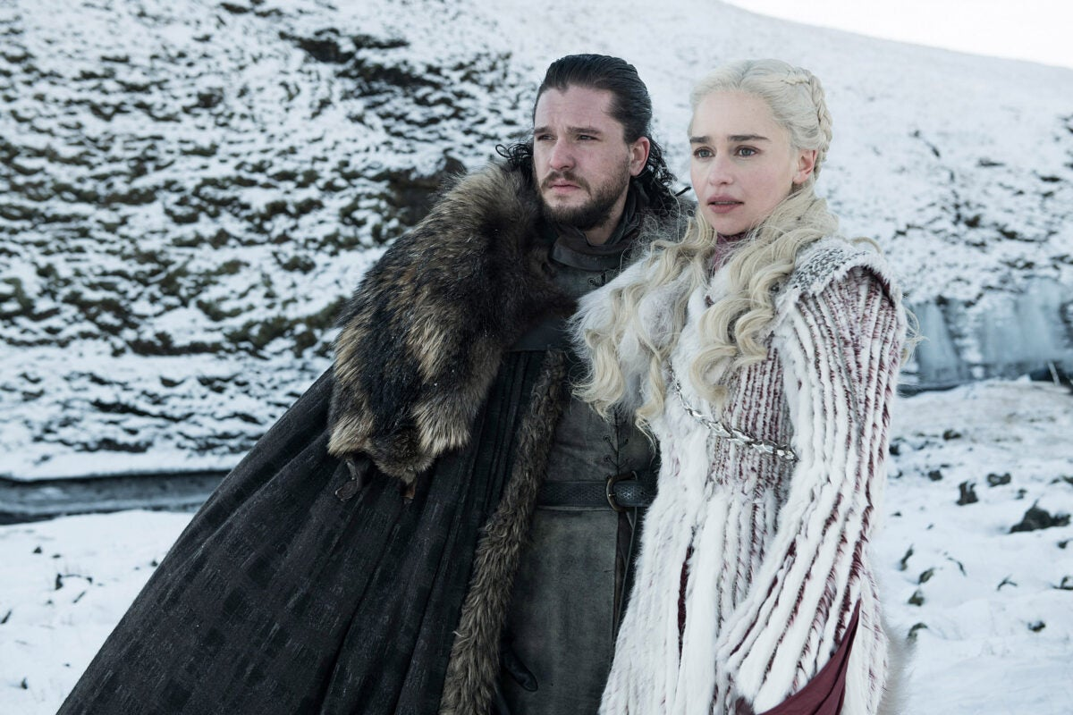Kit Harington as Jon Snow and Emilia Clarke as Daenerys Targaryen.