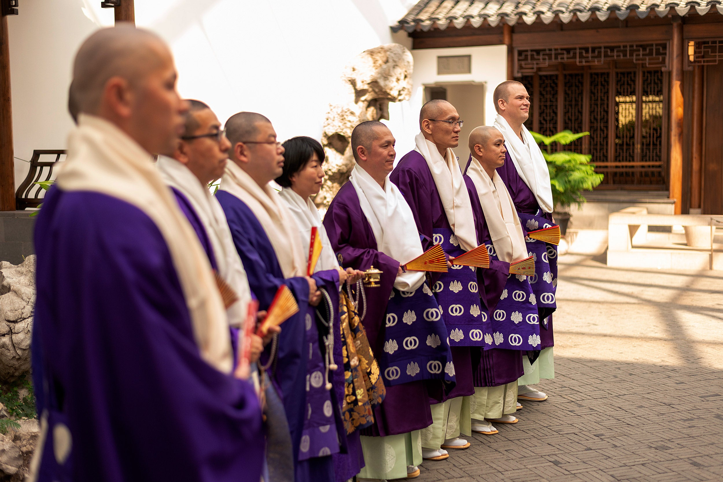 Buddhist priests stand in line during a ceremony