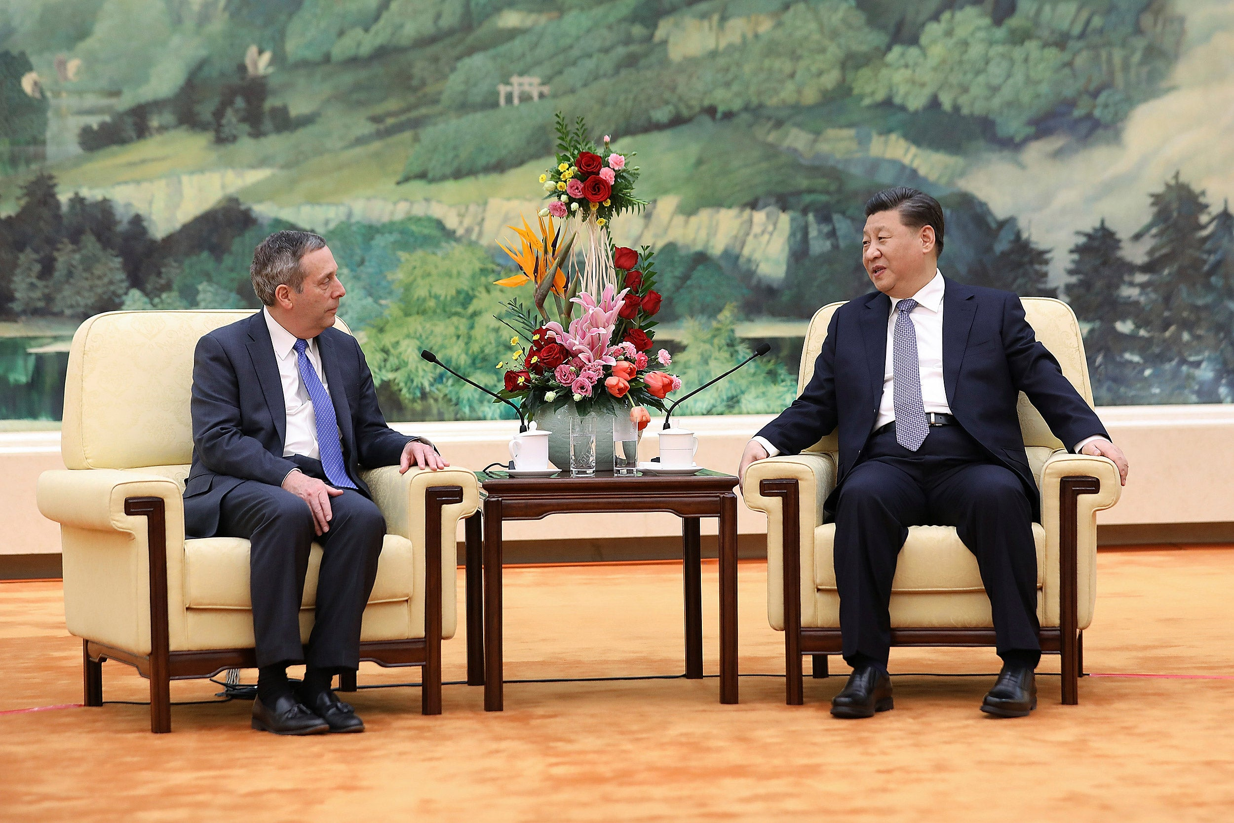 Harvard President Larry Bacow (left) meets with Chinese President Xi Jinping.
