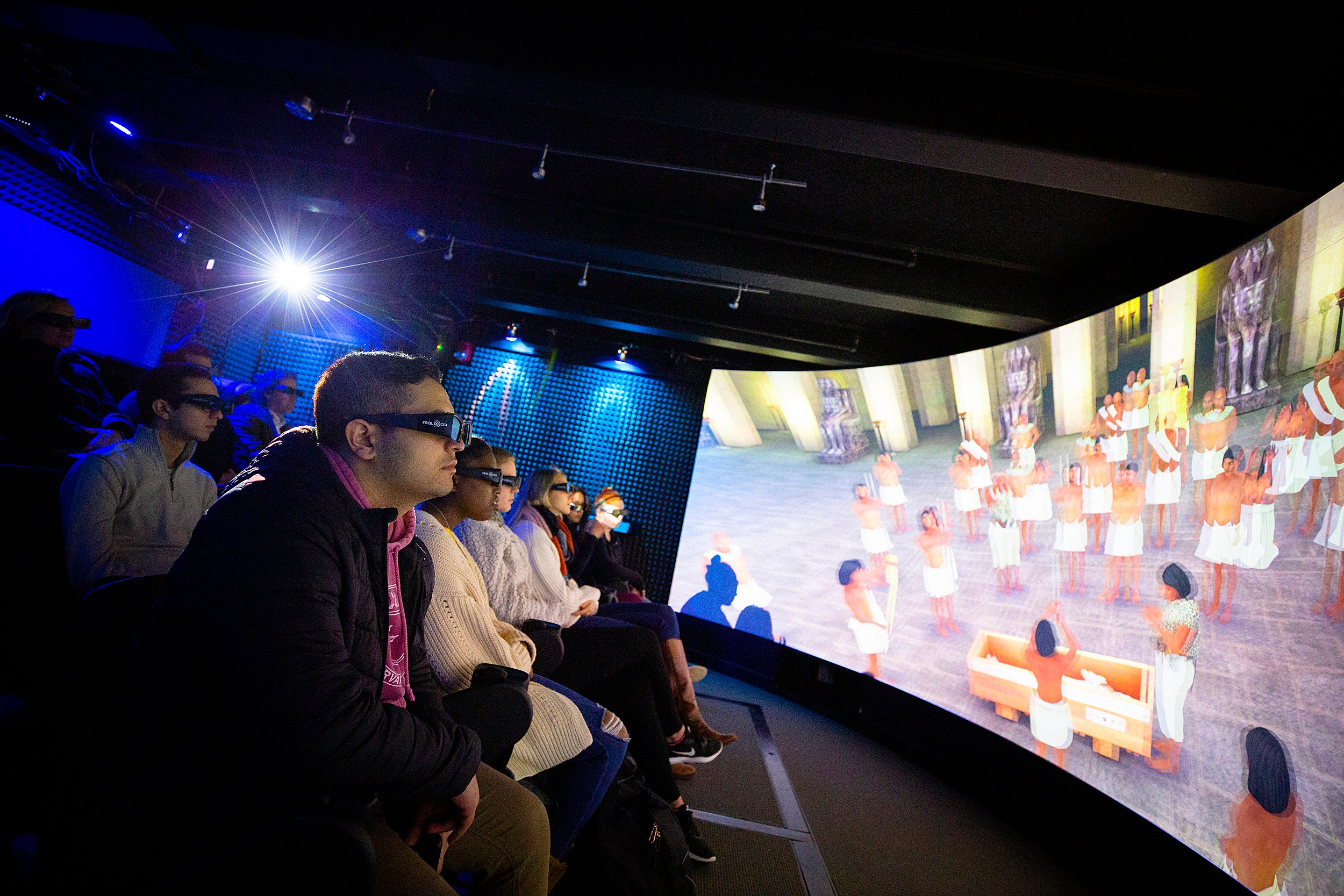 Students wearing 3D glasses view a visualization of an Egyptian tomb.