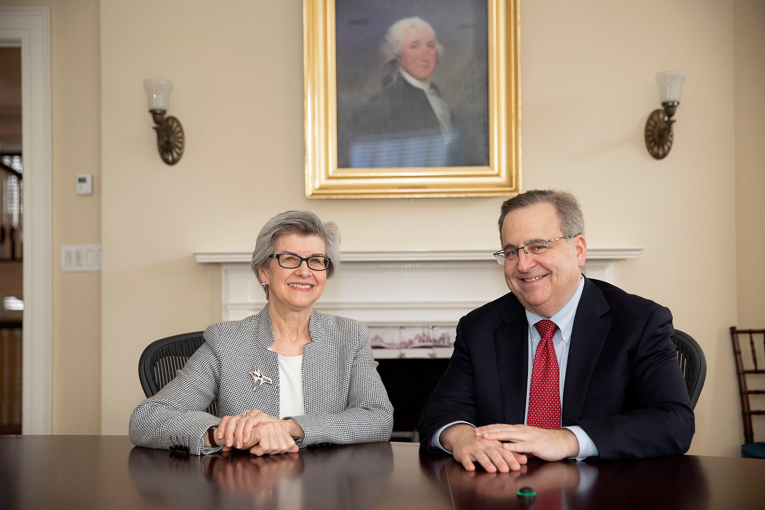 Overseers president Susan L. Carney '73, J.D. '77, and incoming Overseers president Michael Brown '83, J.D. '88