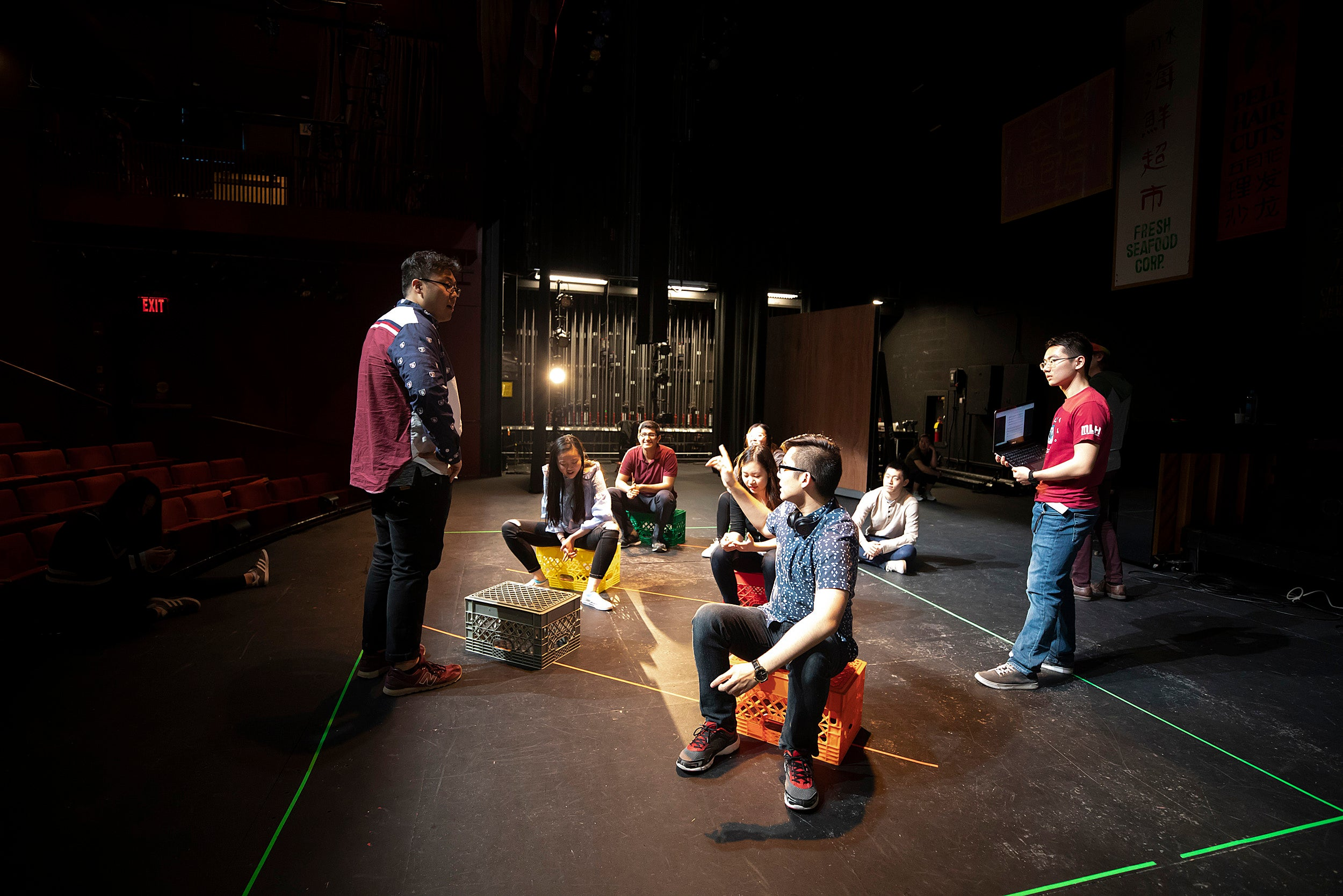 Performers sitting and talking on a stage