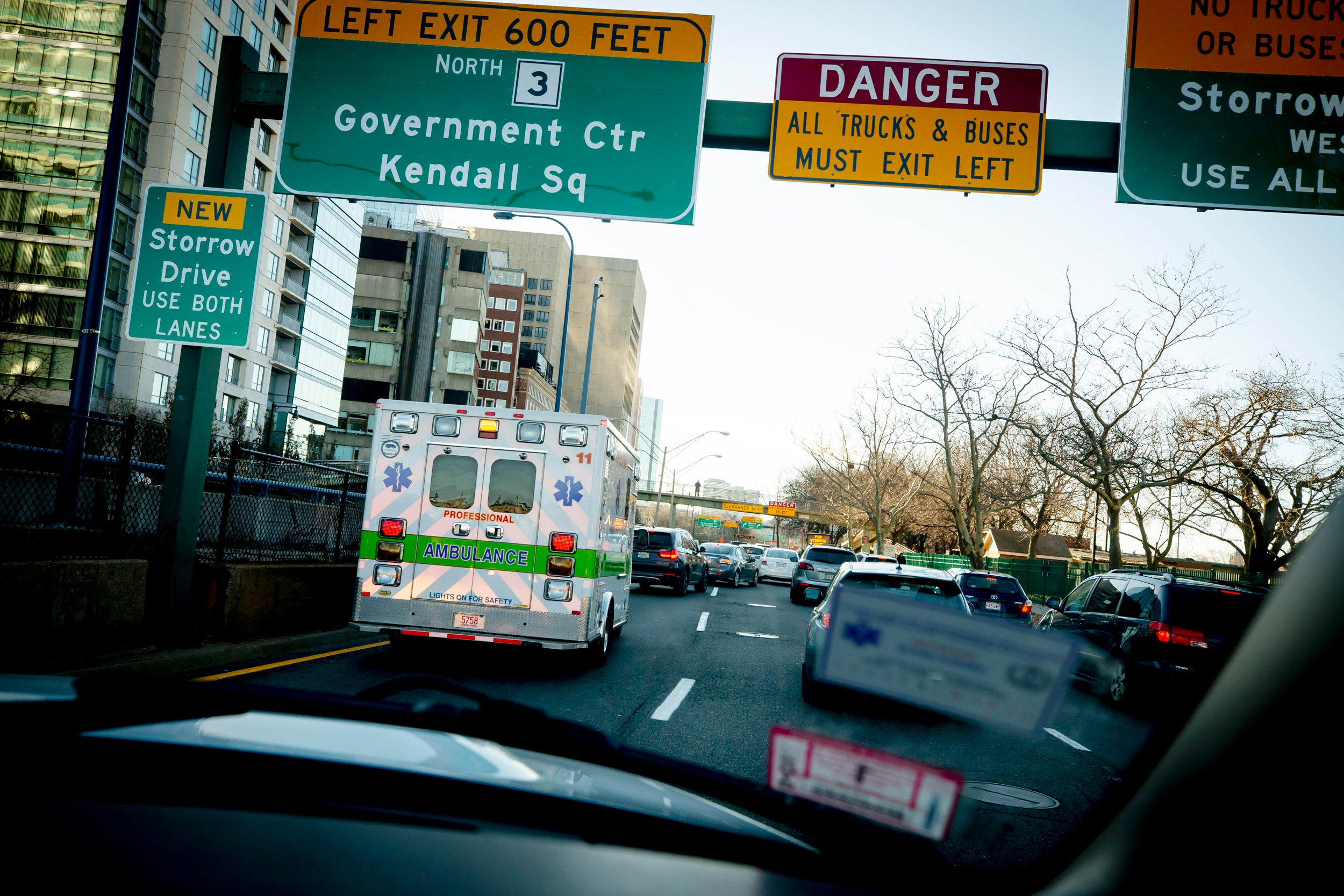 The ambulance navigates Memorial Drive traffic.