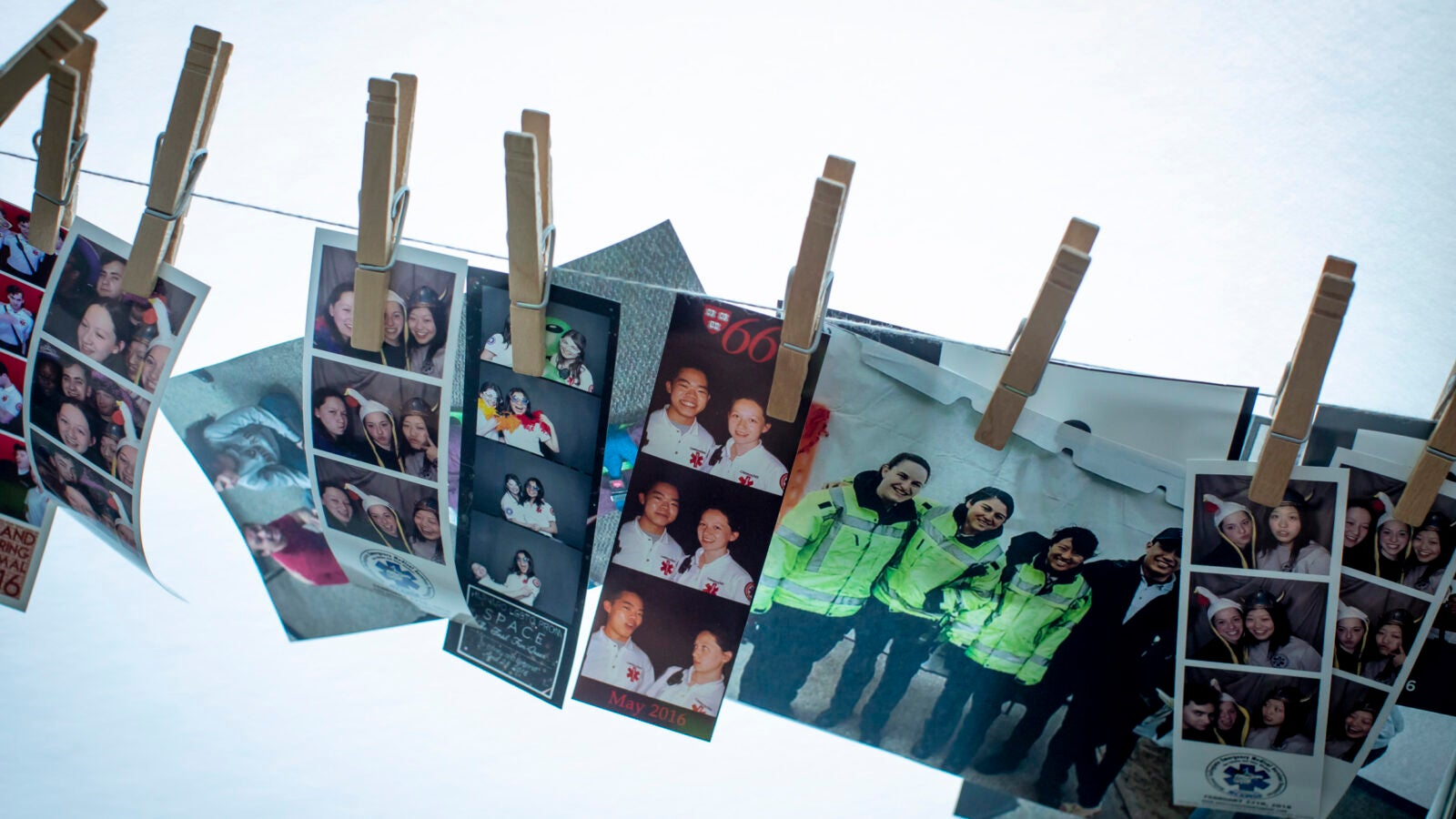 Photos of student EMTs and instructors are clipped to a line at Crimson EMS.