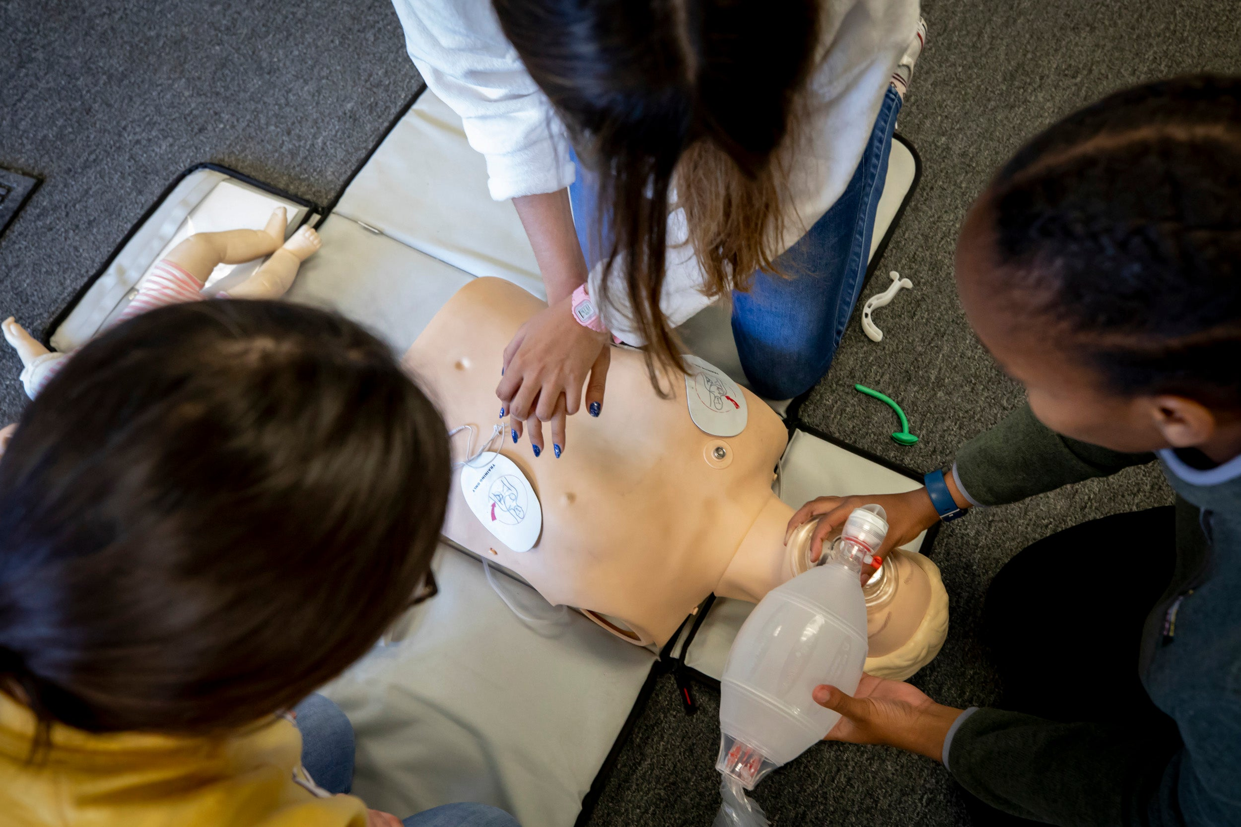 Students practice resuscitation using a dummy.