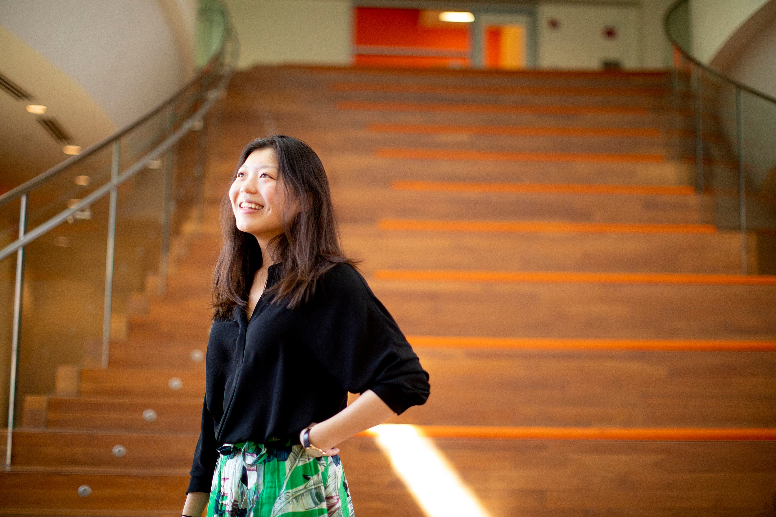 Cynthia Luo in front of stairs