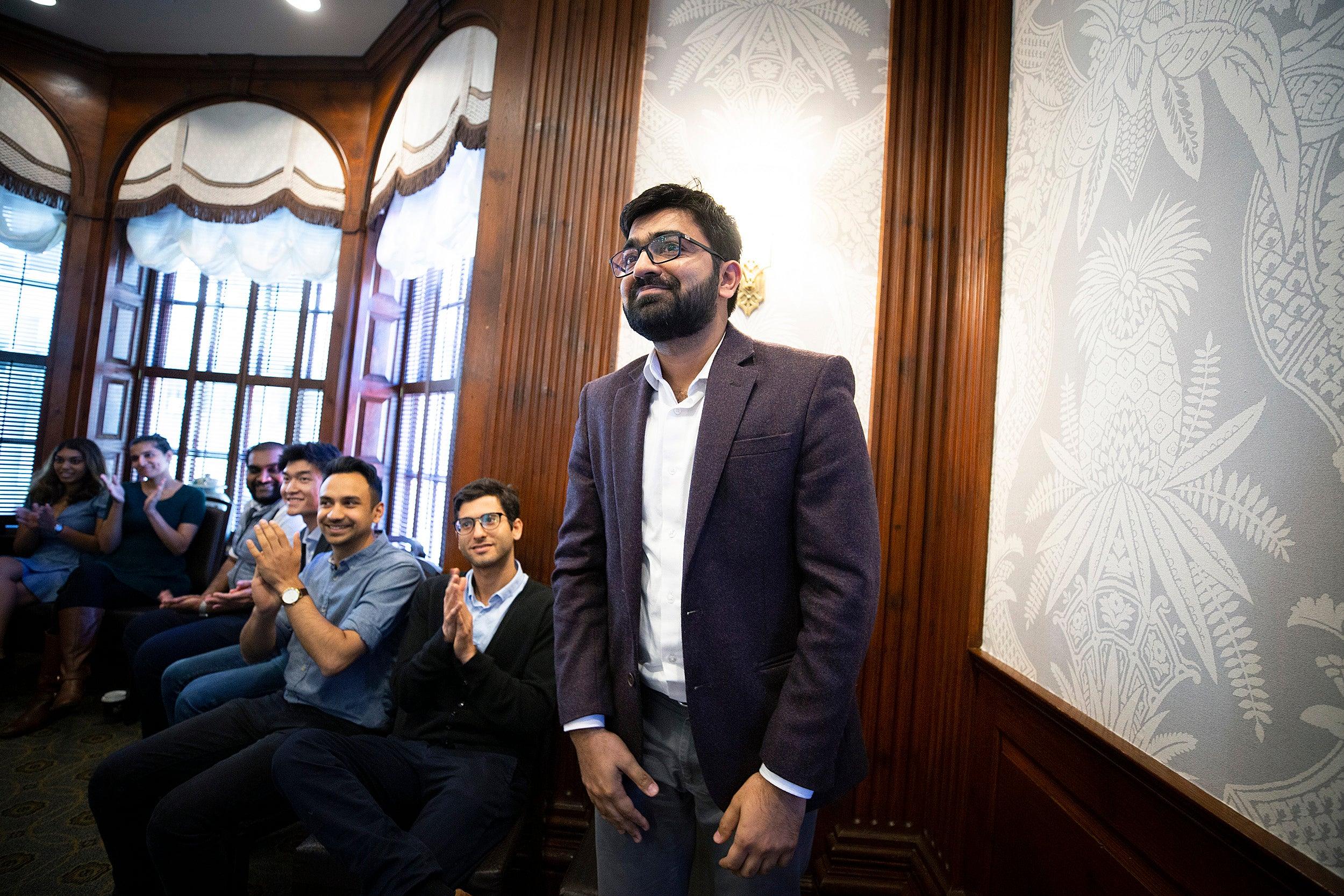 Vikas Birhma '19 (right) is announced as the winner for the organization Gramhal.