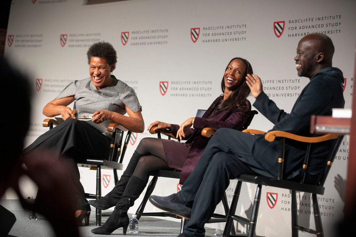 "Panelists Carrie Mae Weems (from left), Sarah Lewis, and David Adjaye share a laugh onstage at the ""Vision & Justice"" conference."