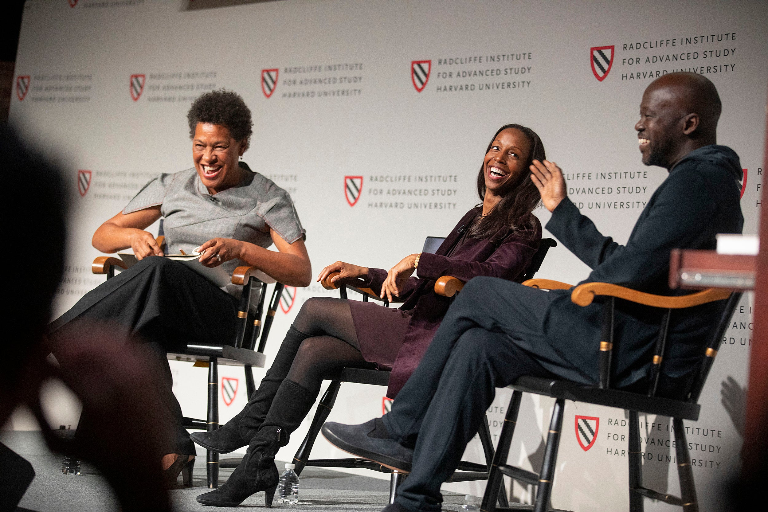 """Panelists Carrie Mae Weems (from left), Sarah Lewis, and David Adjaye share a laugh onstage at the """"Vision & Justice"""" conference."""
