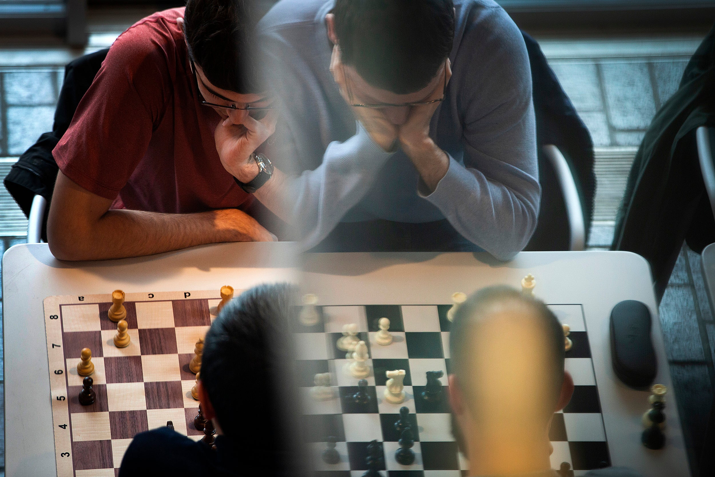 Chess players concentrate.