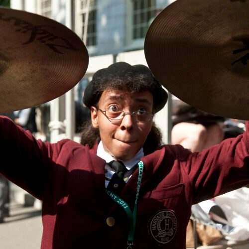 Latonya Wright playing cymbals for the Harvard Band in 2011.